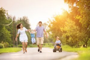 Family walking together down the street after receiving Life Insurance from RG Insurance Agency in Pharr, TX