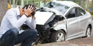 Driver with head in hands after getting into an auto accident