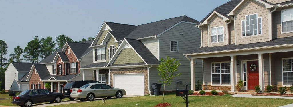 Houses in a residential neighborhood protected by home insurance